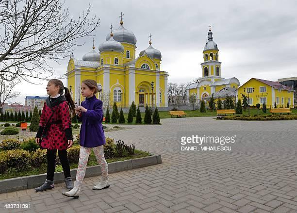 Children walk in a park in Comrat city the main city of Gagauzia on April 6 2014 Gagauzia an autonomous region of Moldova where nostalgia for the...
