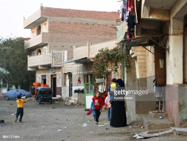 Children walk in the Egyptian village in the suburbs of Faiyum on Nov 30 where Mahmoud Shafiq who carried out a suicide bombing terrorist attack in...