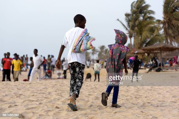 MAHONY Children walk on the beach of Kololi on April 9 2017 For decades The Gambia has built a reputation as a haven for tourists willing to pay for...