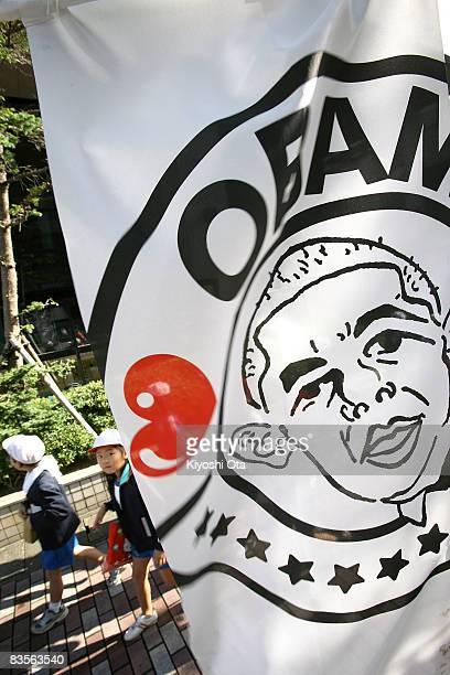 Children walk past a I Love Obama banner in support of the Democratic presidential candidate US Sen Barack Obama on November 5 2008 in Obama Fukui...