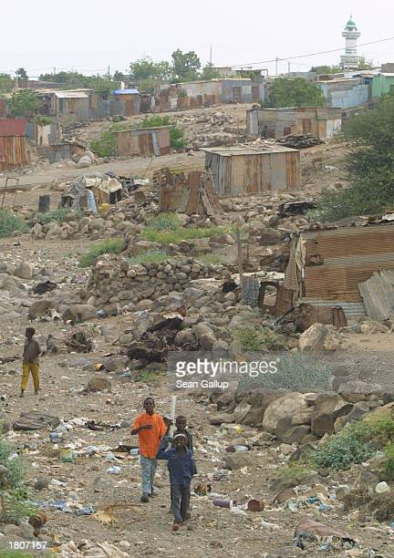Children walk through the BaalBalla slum February 21 2003 in the outskirts of Djibouti Town Djibouti BaalBalla is one of many Djibouti slums swollen...
