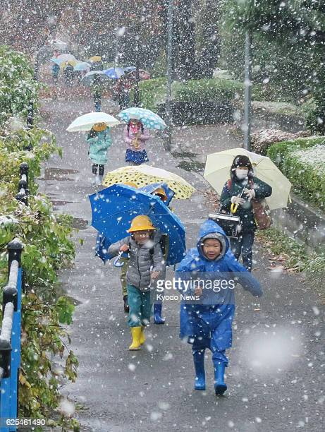 Children walk to their elementary school in Chofu Tokyo on the morning of Nov 24 the day when the Japanese capital had snowfall in November for the...