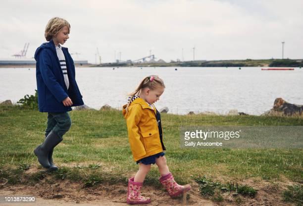 Children walking along the marina