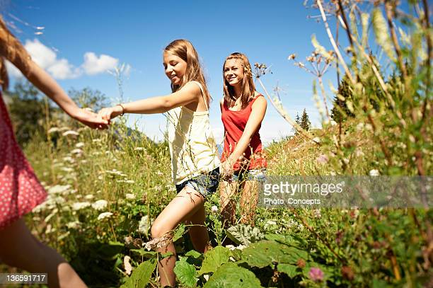 children walking and holding hands - mid section stock pictures, royalty-free photos & images