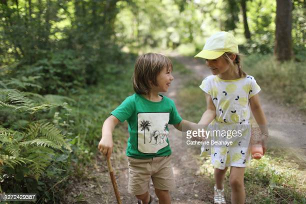 2 children walking around the woods - exploration stock pictures, royalty-free photos & images
