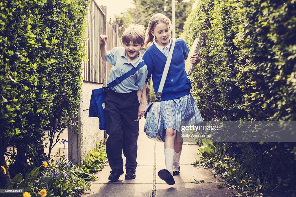 Children walking home from school : Stock Photo
