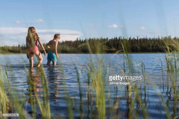 Children walking in lake