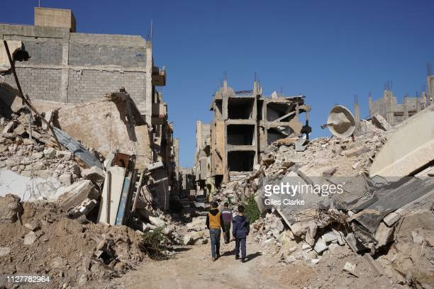 Children walking in the damaged building located in Benghazi's Old Town on February 2,2019 in Libya. After the Libyan revolution in 2011 and the...