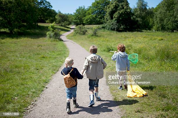 Children walking on dirt road