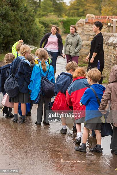 Children Walking Out of School To Meet Parents