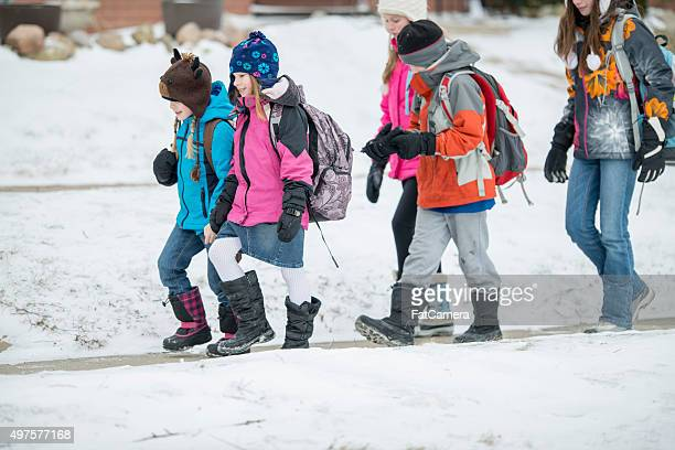 children walking outside in winter - snow boot stock photos and pictures