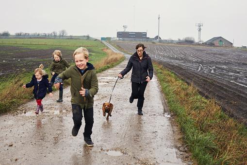 Children walking the dog together - gettyimageskorea