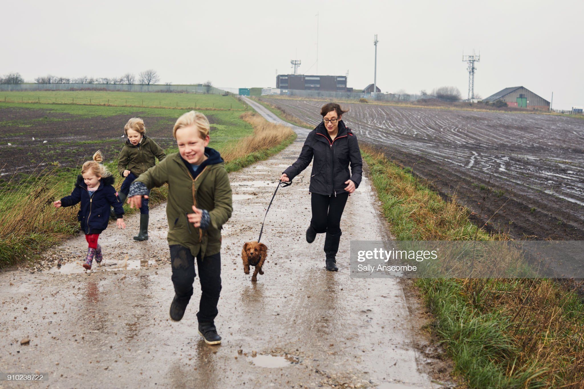 Children walking the dog together : Stock Photo
