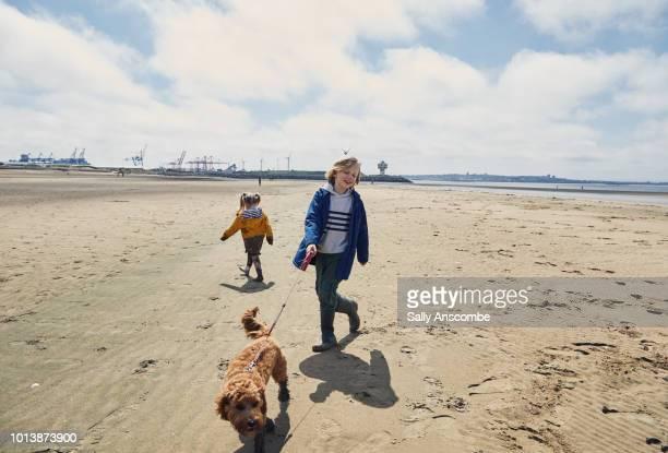Children walking their pet puppy dog
