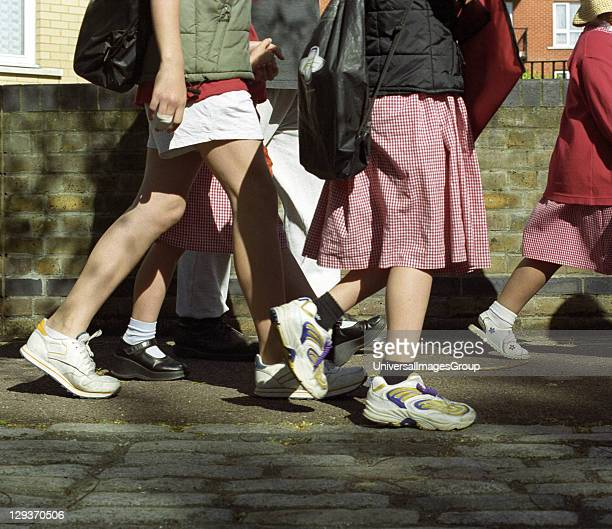 Children walking to school, not travelling by car and therefore cutting down on pollution and carbon dioxide emissions, United Kingdom.