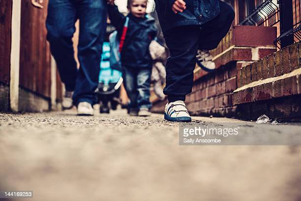 children walking with their parents - preschool child stock pictures, royalty-free photos & images