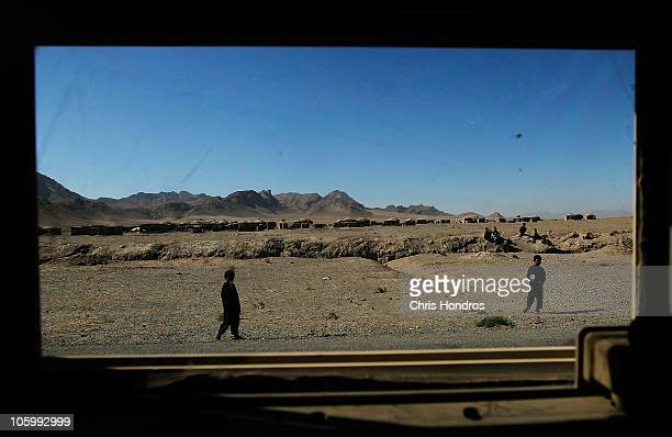 Children wanter on the side of a highway as seen through the window of a US Army Humvee October 24 2010 on the outskirts of Herat Afghanistan Herat...