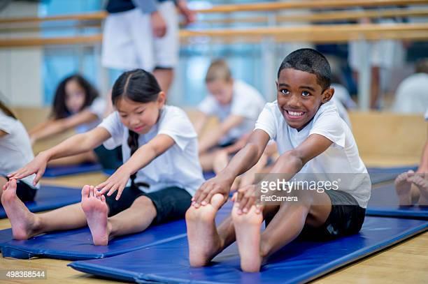Children Warming Up in Gym Class