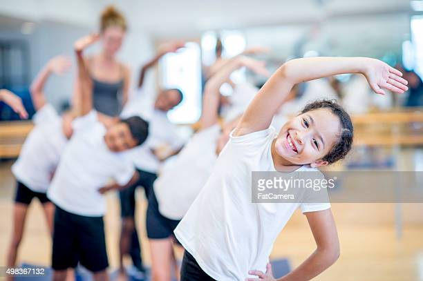 children warming up together at the gym - physical education stock pictures, royalty-free photos & images