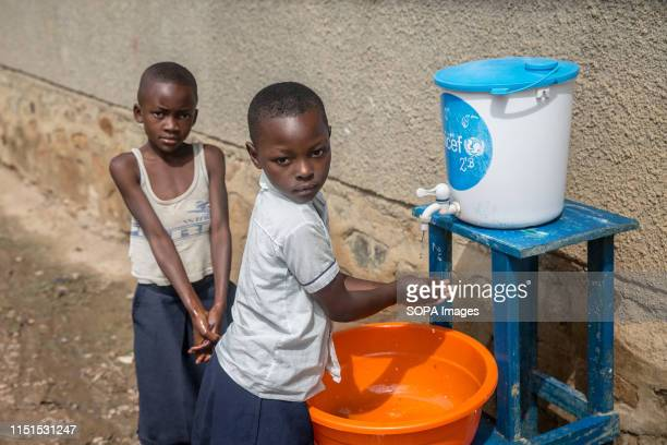 Children wash their hands with chlorinated water at a primary school as part of a preventive initiative aimed at halting the spread of Ebola in Beni...