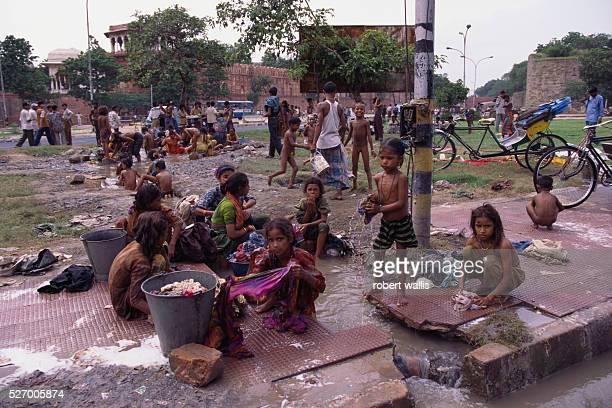 Children Wash up in Delhi Slum