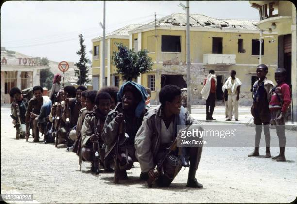 Children watch a squad of Eritrean People's Liberation Front fighters passing through the town of Keren on their way to the frontline 20th July 1978
