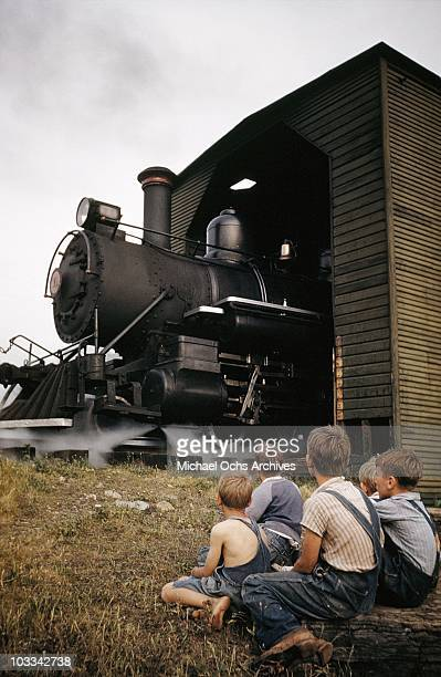 Children watch a vintage narrow guage steam engine on the East Tennessee Western North Carolina railway running the 65 miles between Johnson City...