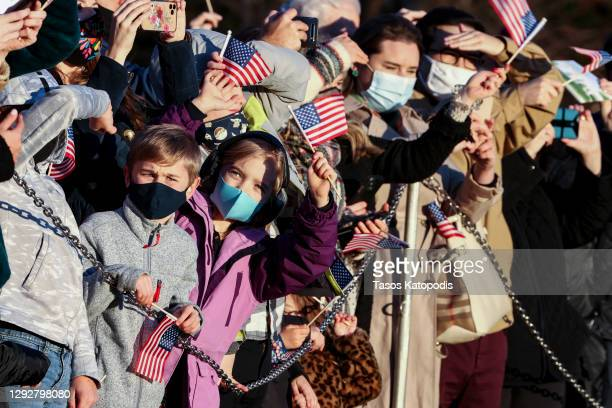 Children watch as Marine One departs from the south lawn of the White House on December 23, 2020 in Washington, DC. President Trump and first lady...