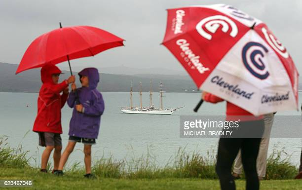 Children watch as the Bach Esmerelda from Chile sails into the Waitemata Harbour as part of the fleet entry to celebrate the Royal New Zealand Navy's...