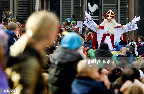 Children watch as the Sinterklaas procession arrives arrives in Dordrecht on November 13 2011 AFP PHOTO/ ANP/ KOEN VAN WEEL netherlands out belgium...