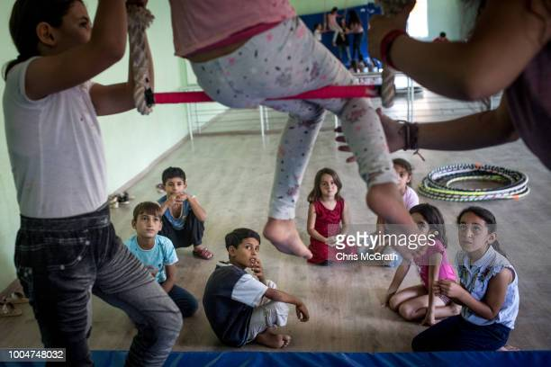 Children watch on during a trapeze workshop at the Istasyon Sirkhane Center on July 24 2018 in Mardin Turkey The circus school or Her Yerde Sanat...
