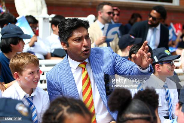 Children watch the match with MCC President Designate Kumar Sangakarra in the Pavilion at Lord's Cricket Ground on July 5, 2019 in London, England....