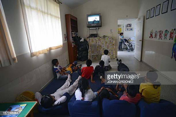 Children watch TV at San Jose orphanage in Santa Lucia Milpas Altas municipality Sacatepequez departament 28 km south of Guatemala City on November...