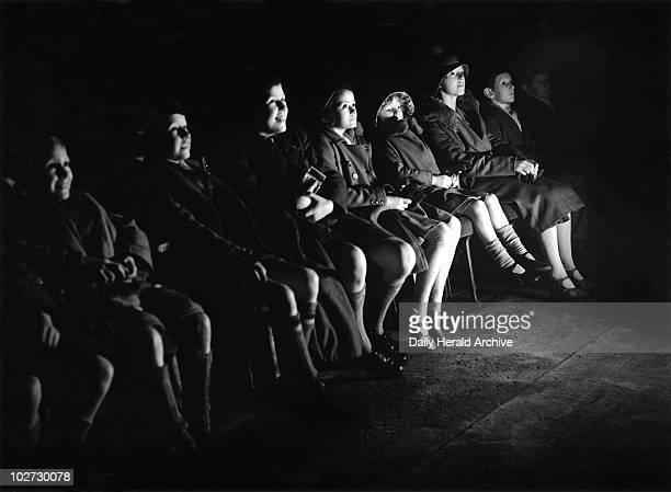 Children watching a Mickey Mouse film 5 January 1934 Photograph by James Jarche for the Daily Herald newspaper