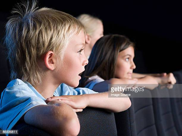 children watching a movie - redoubtable film stock photos and pictures