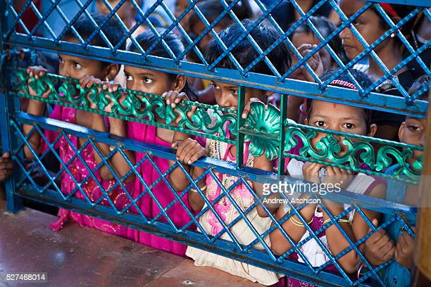 Children watching a performance by the Street Law Programme organised by CLAP Committee for Legal Aid to Poor Cuttack city Orissa India