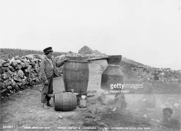 Children watching a Poteen still in Connemara County Galway Poteen is illicit alcohol made from potatoes Photo taken by Irish photographer Robert...