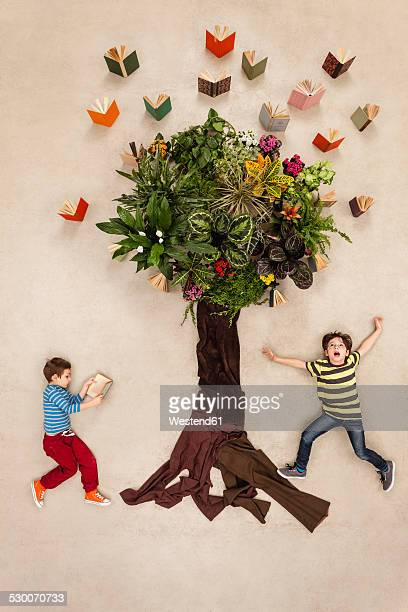 Children watching books flying out of tree