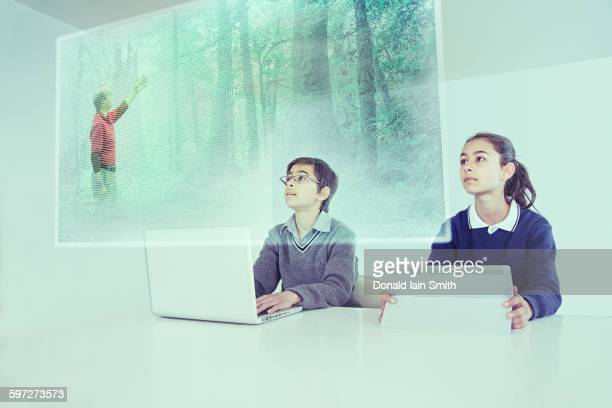 Children watching floating screen in online class