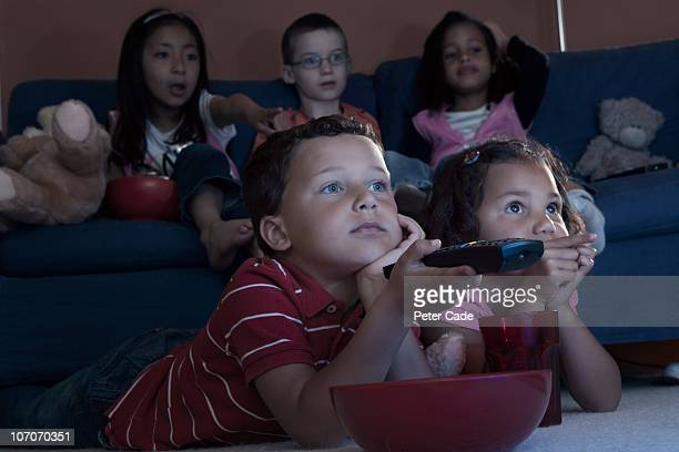 children watching television - close to stock pictures, royalty-free photos & images