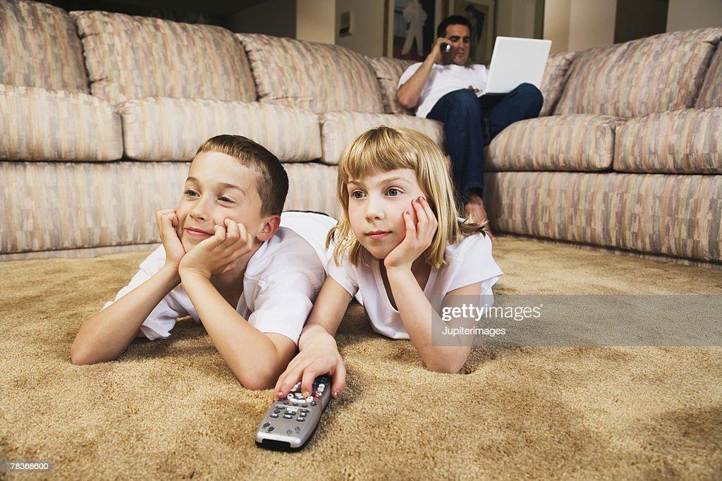 Children watching television : Stock Photo