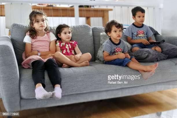 children watching tv/film together - rafael ben ari bildbanksfoton och bilder