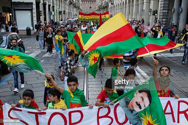 Children wave flags as they join in a protest against Kurdish President Hundreds of people protested against the attacks of the Kurdish people at the...