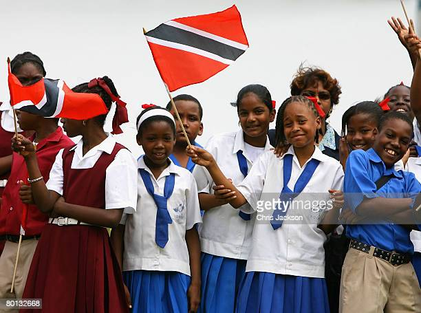Children wave flags at Queen's Cricket ground on the second day of a three day tour of Trinidad and Tobago on March 5, 2008 near Port of Spain,...