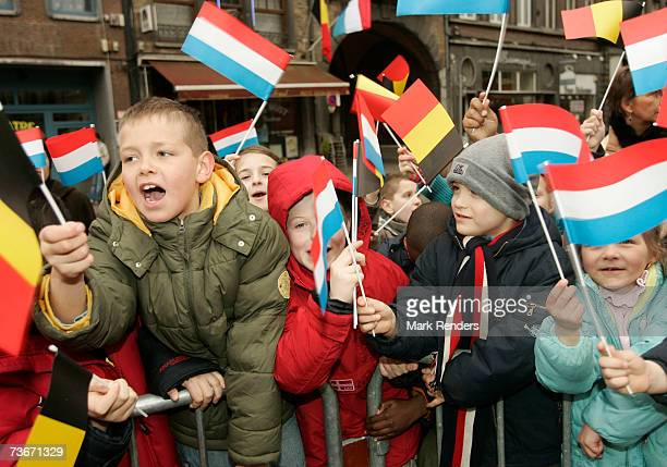Children wave flags from Belgium and Luxembourg at the Royal Namur Theatre on March 22 2007 in Namur Belgium Henri Grand Duke of Luxembourg and his...