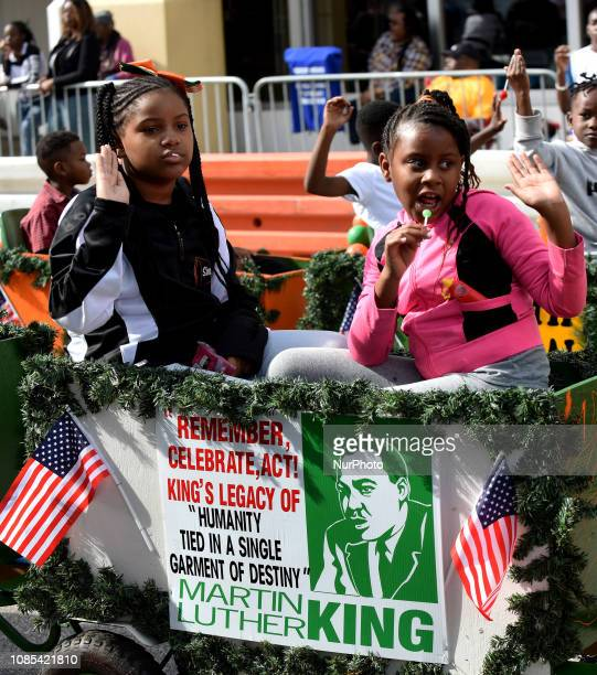 Children wave from a float in the annual Dr Martin Luther King Jr Day Parade on January 19 2019 in Orlando Florida