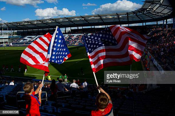Children wave the American flag before the international friendly match between Bolivia and United States on May 28 2016 at Children's Mercy Park in...