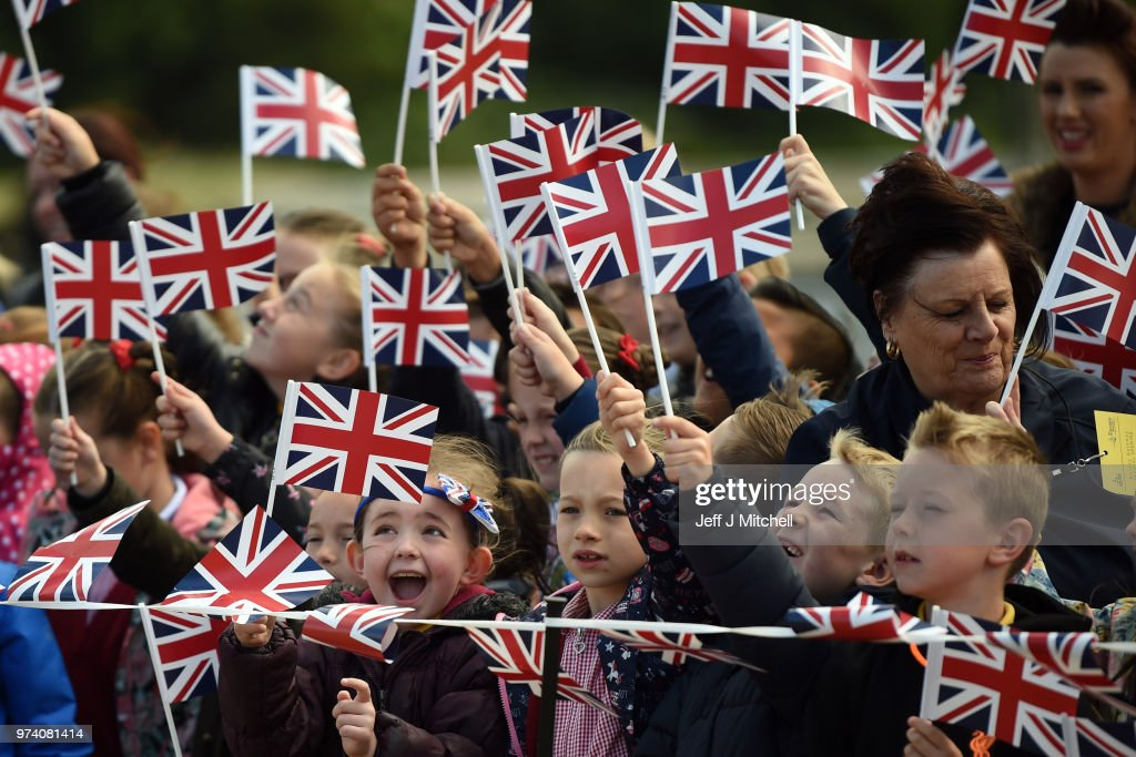 Children wave the Union Jack flag as they await the arrival of Queen Elizabeth II and Meghan, Duchess of Sussex to open the new Mersey Gateway Bridge on June 14, 2018 in the town of Widnes in Halton, Cheshire, England. Meghan Markle married Prince Harry last month to become The Duchess of Sussex and this is her first engagement with the Queen. During the visit the pair will open a road bridge in Widnes and visit The Storyhouse and Town Hall in Chester.