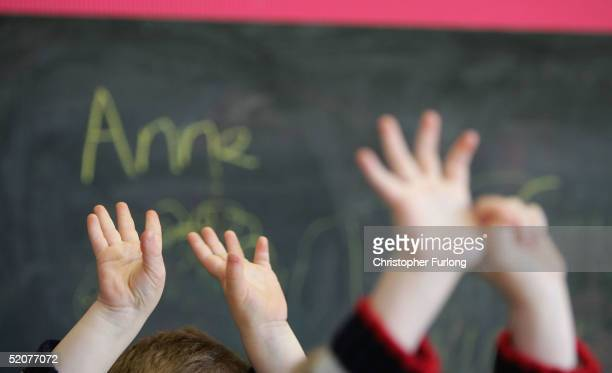 Children wave their hands at a private nursery school January 28 2005 in Glasgow Scotland The average price of preschool care has increased over the...
