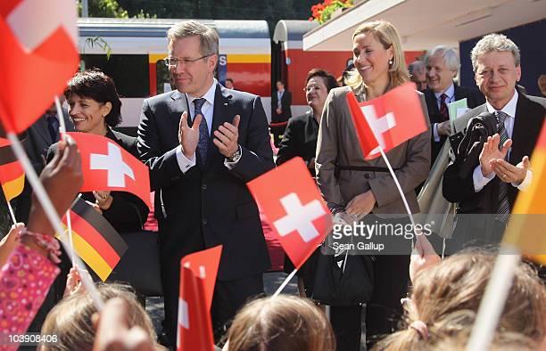 Children waving German and Swiss flags greet German President Christian Wulff his wife First Lady Bettina Wulff Swiss President Doris Leuthard and...